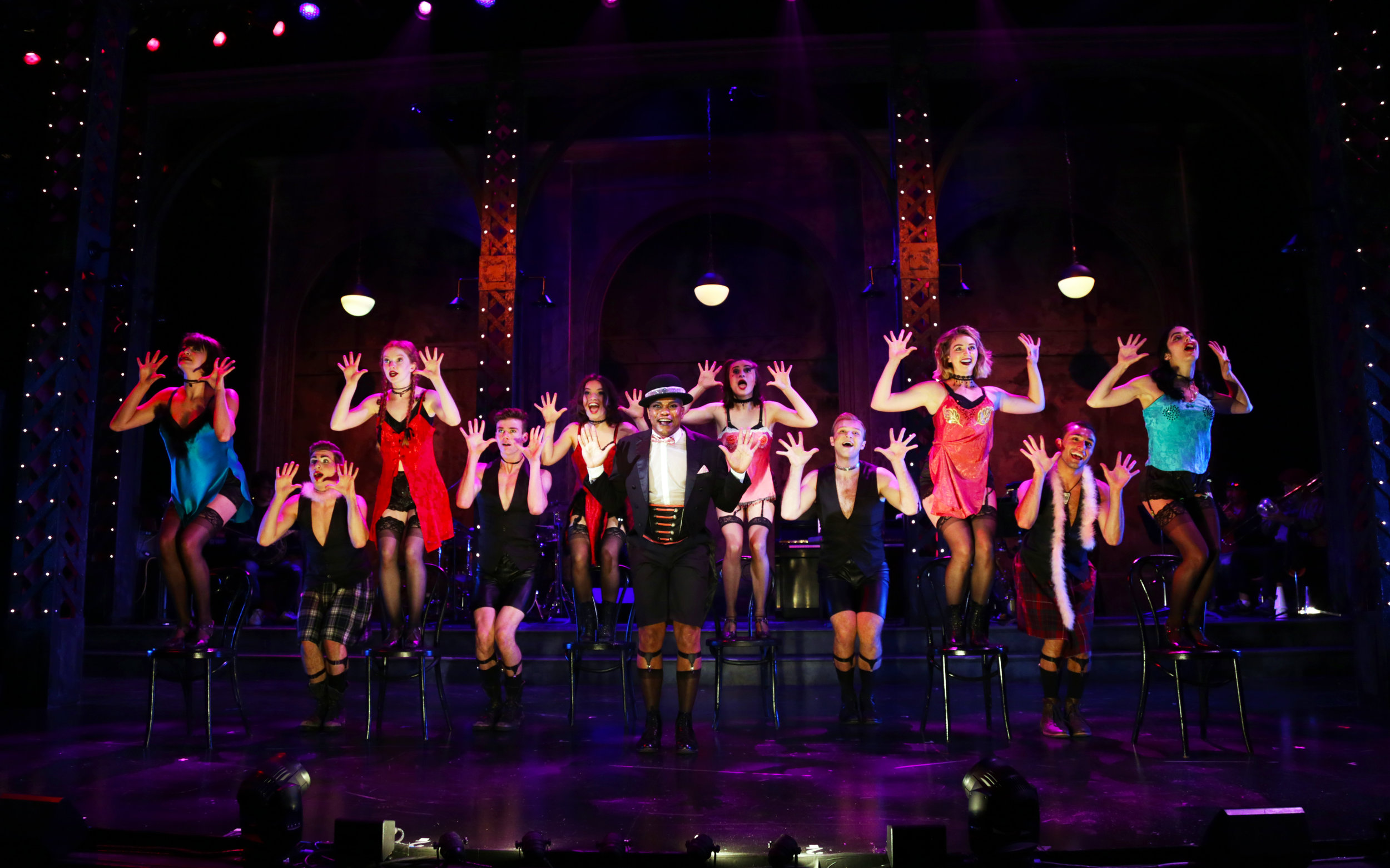 The Emcee (Forrest McClendon), center, and the Kit Kat girls and boys