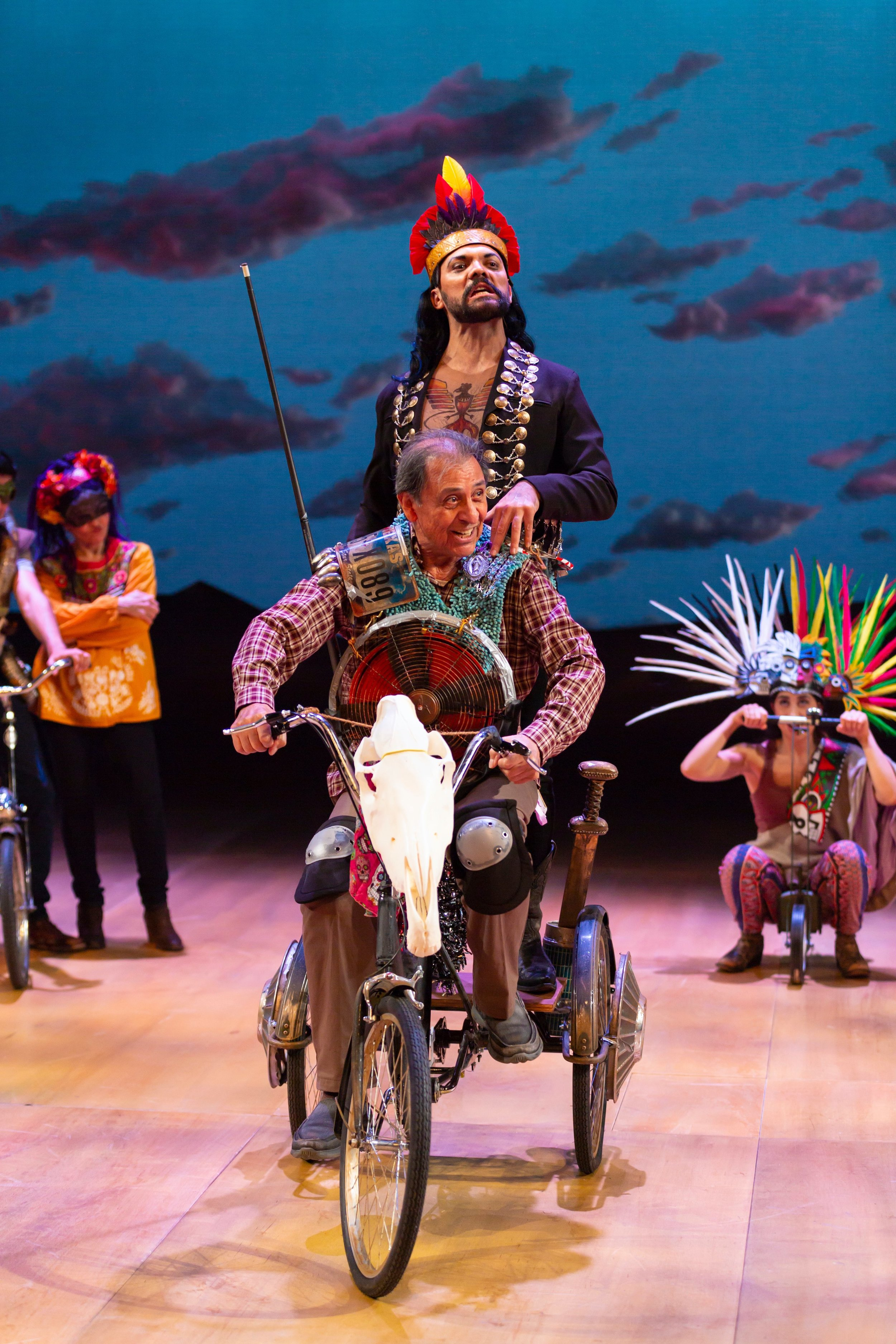 Jose Quijano/Don Quixote (Emilio Delgado), front; Papa Calaca (Hugo E. Carbajal), rear, with the cast of  Quixote Nuevo  at Hartford Stage (photos by T. Charles Erickson)