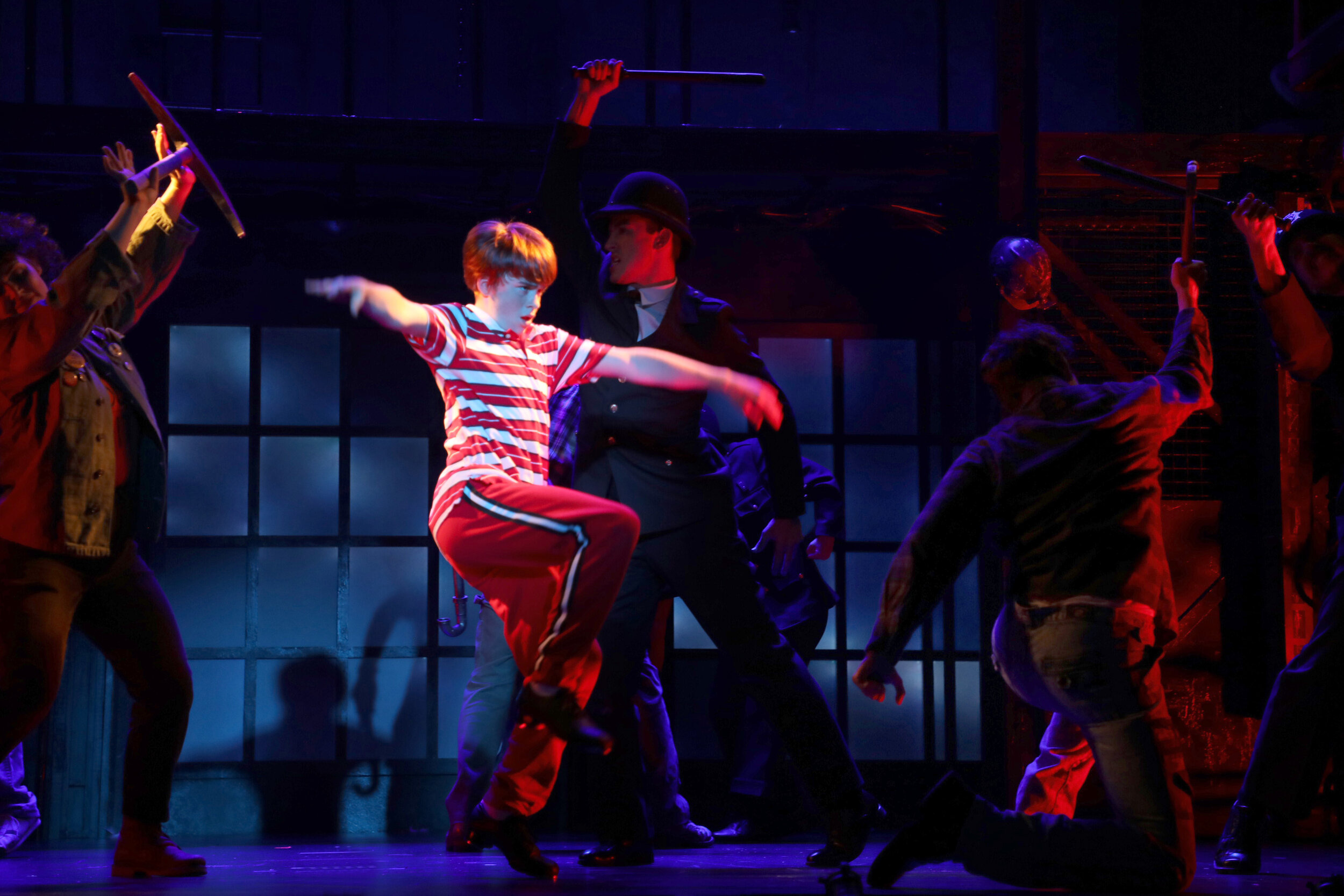 Billy Elliot (Liam Vincent Hutt) with the cast of Goodspeed Musicals'  Billy Elliot The Musical , now playing at The Goodspeed through November 24. Photo by Diane Sobolewski.