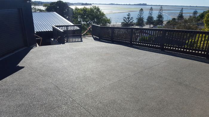 1 (4)black exposed aggregate concrete - mt pleasant christchurch(before and afters)_1.jpg