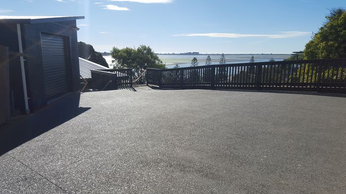 1black exposed aggregate concrete - mt pleasant christchurch(before and afters)_1.jpg