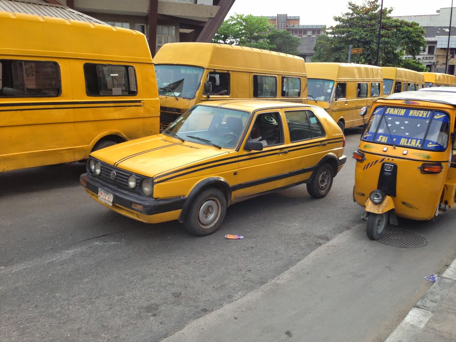 L-R: Buses, Yellow taxi, keke napeps
