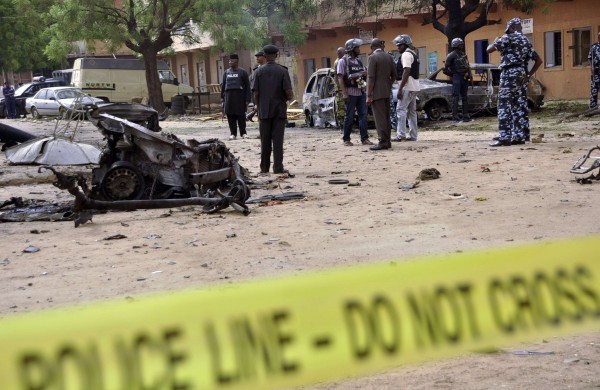 Nigerian Police Force Inspecting a scene after a bomb attack // Source: www.informationng.com/