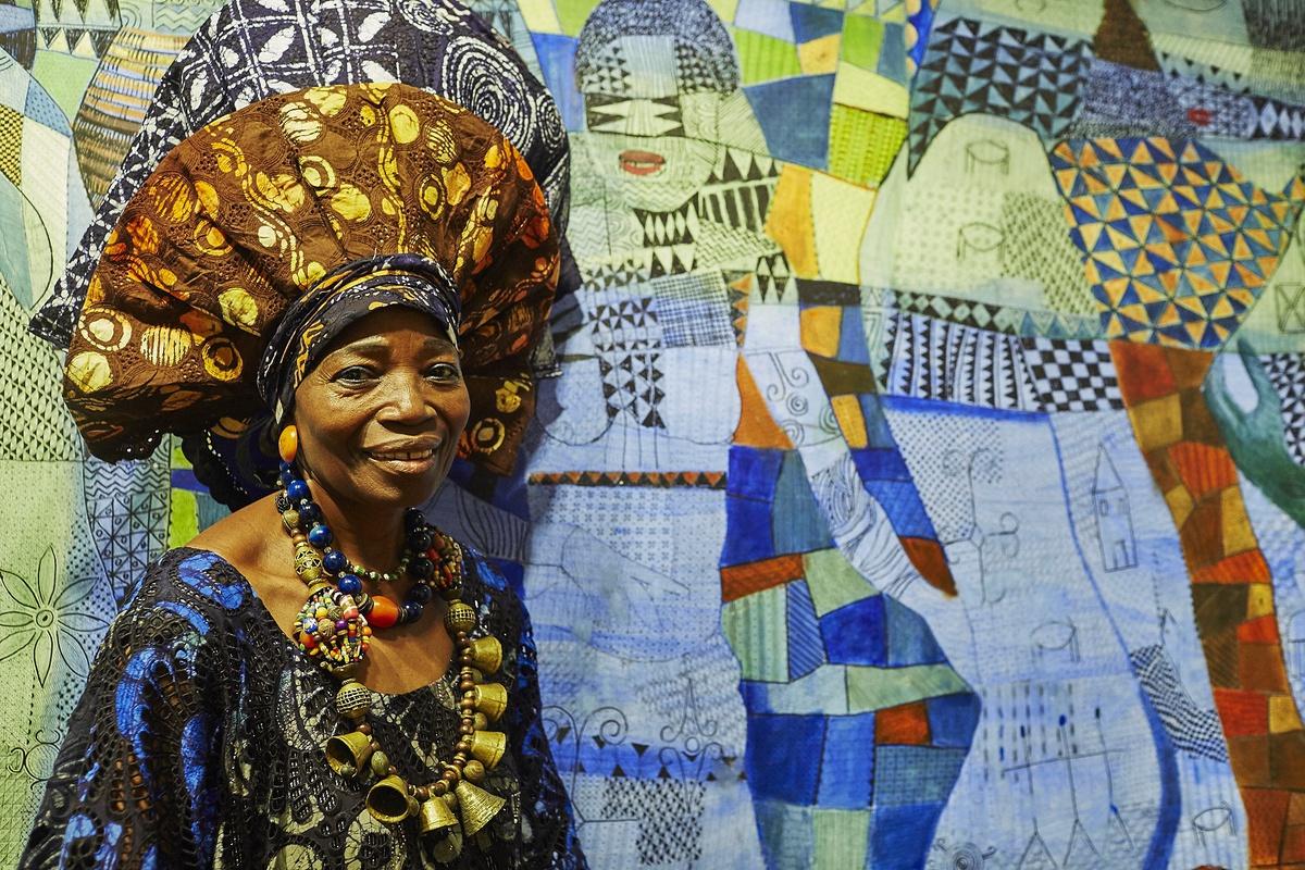 MRS NIKE OKUNDAYE WITH SOME OF HER ARTWORKS