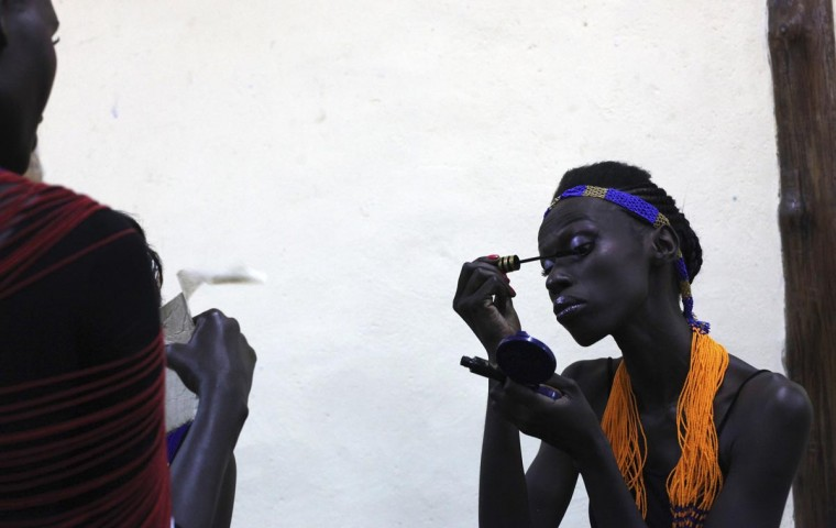 A South Sudanese model prepares backstage during the second edition of Festival for Fashion and Arts for Peace, featuring three South Sudanese designers, in the capital Juba, August 10, 2013. (Andreea Campeanu/Reuters)