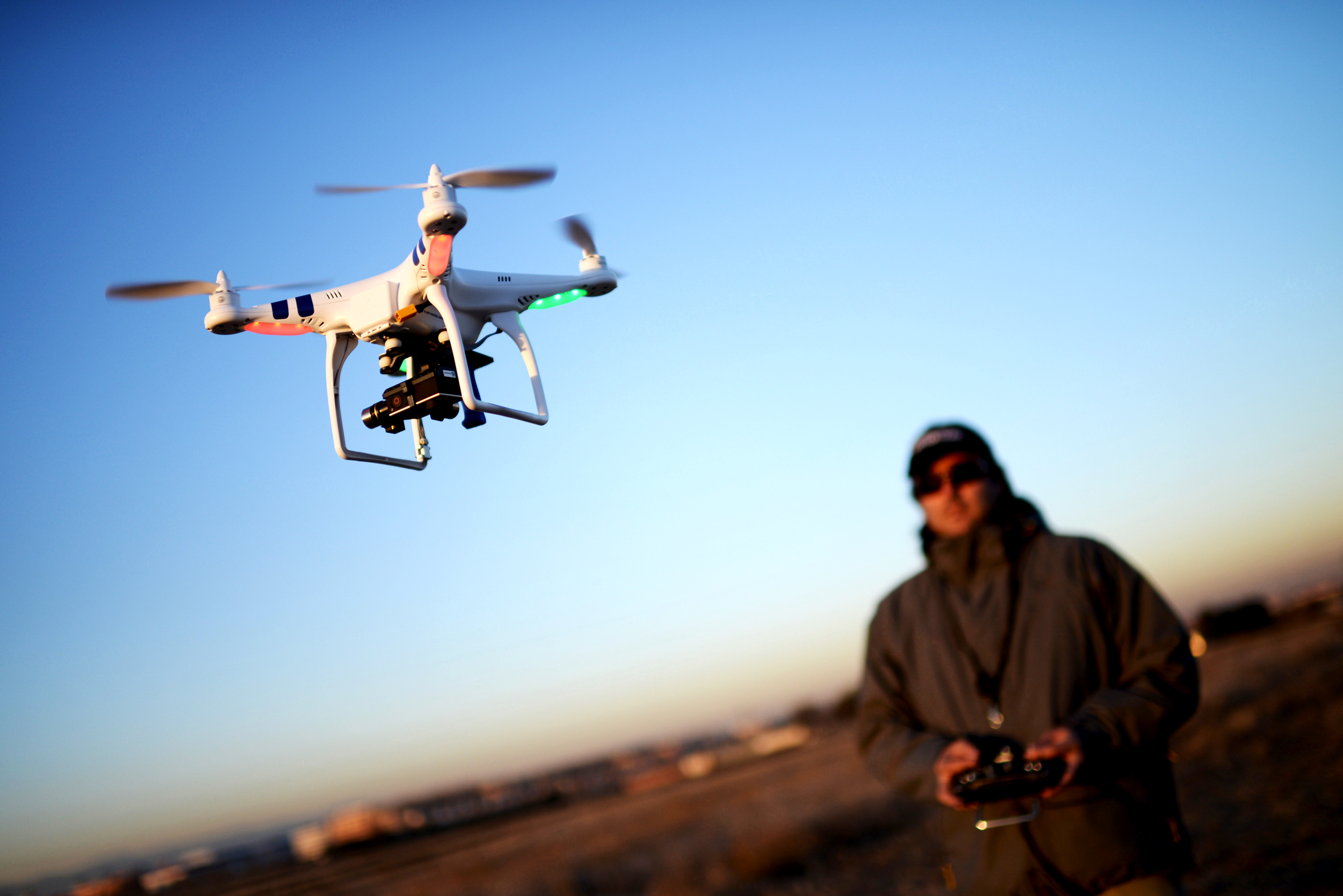 Man flying a Drone // Source: wired.com