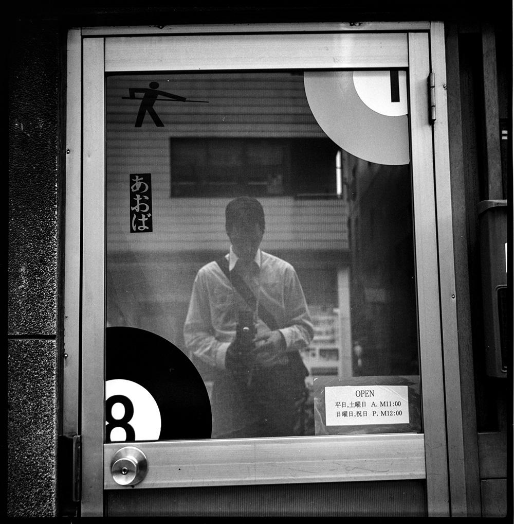 Self Portrait, Ochanomizu, Japan, 2006. By  Philip LePage