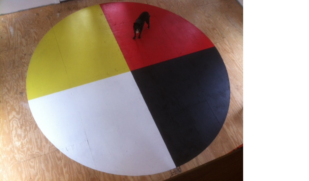 Medicine wheel, painted before the finished floor was installed