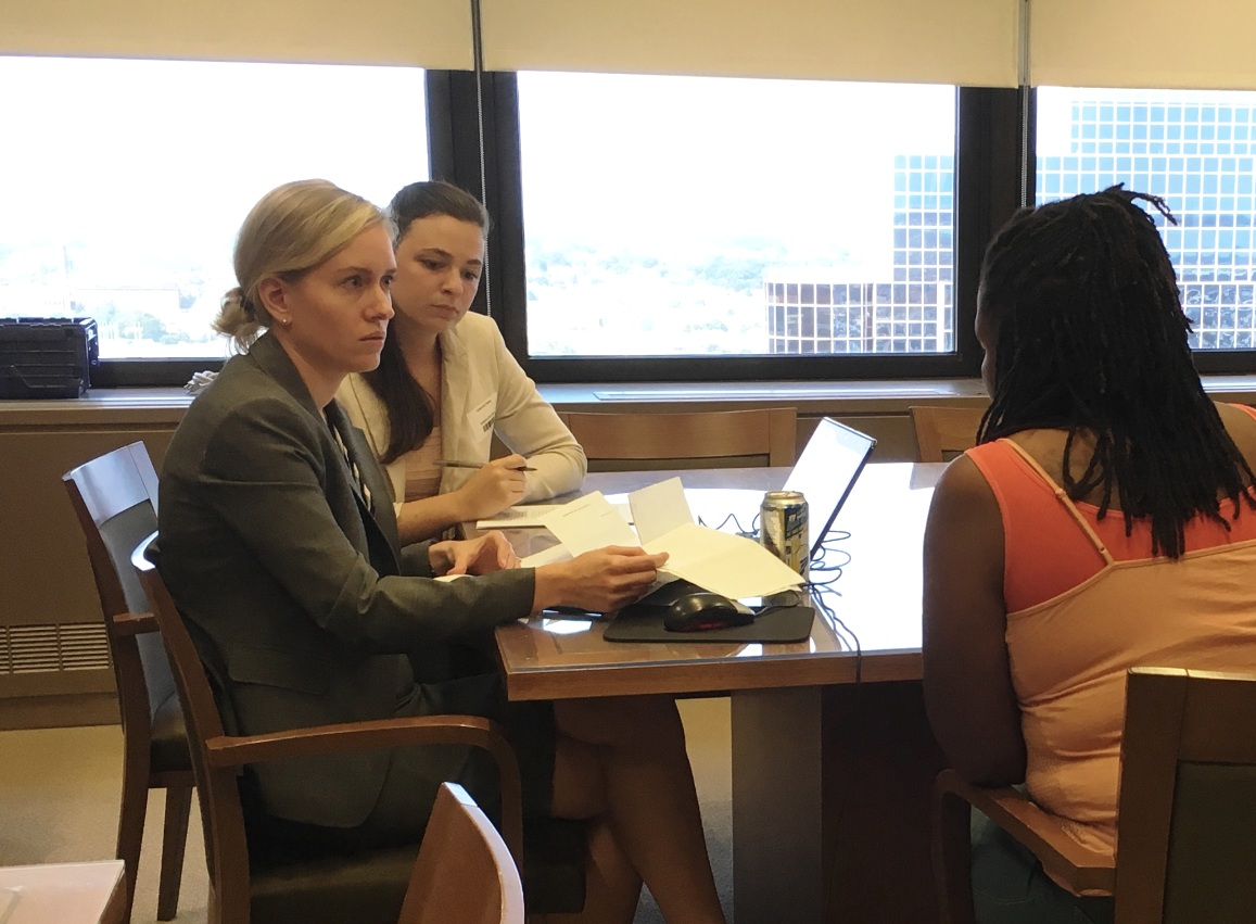 Kate Petrie sits with one of our volunteer attorneys at an expungement clinic