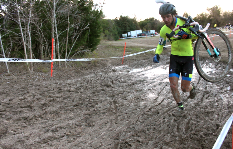 Paul Bonds slogging through the mud with ease. Wonder if his rodeo skills help in these cases!