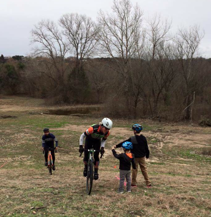 Steven Price takes a hand-ups from the kids: must be a CX race! #willraceforbeer #thankskids