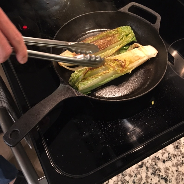The recipe called for grilling the romaine, but my well-seasoned, well-used cast iron pan worked just as well and offered the same smoky flavors. Since this is just a medium-sized pan, I had to trim the lettuce a bit. Looks like I need to add a larger cast iron pan to the cabinet.