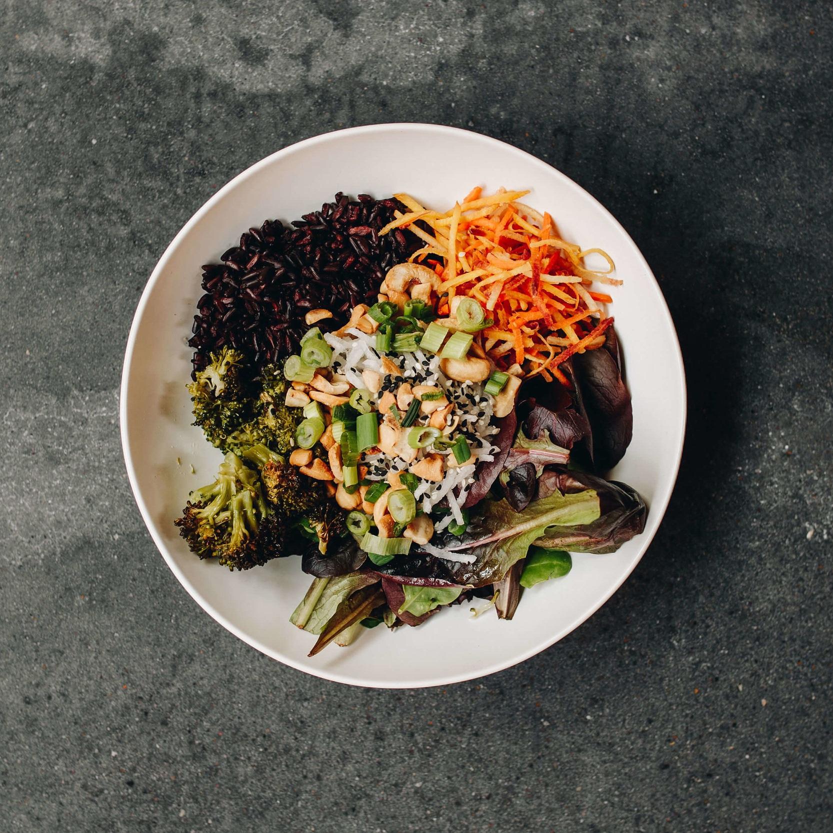 Thai Cashew Bowl - Mixed greens, black rice, radish, rainbow carrot, broccoli, sunflower sprouts, green onion, cilantro, roasted cashews, sesame seeds, Thai cashew dressing9.00