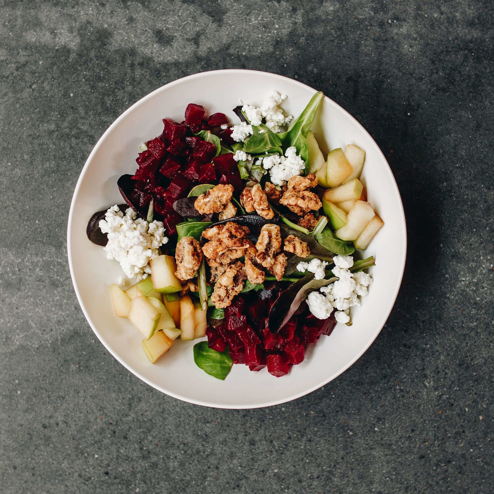 LOCAL ROOTS - Mixed greens, roasted beets, Brussel sproutsl, local goat cheese, caramelized walnuts, maple sherry dressing8.50