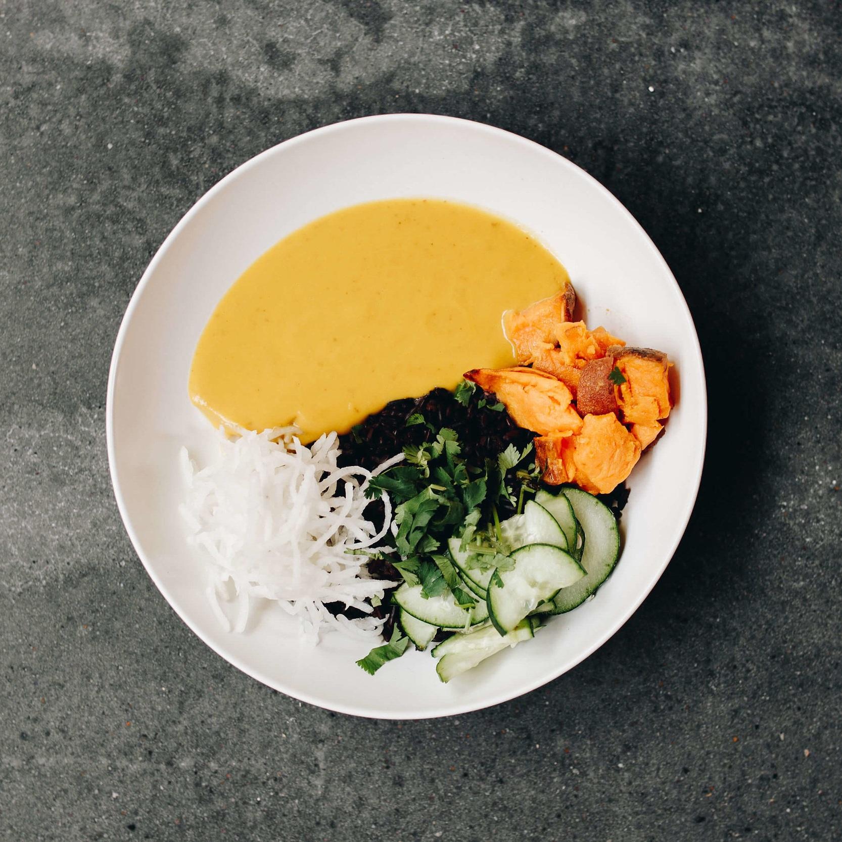 Thai Bowl - Thai sweet potato coconut sauce, forbidden black rice, roasted sweet potatoes, daikon, cucumber, cilantro, thai basil7.50