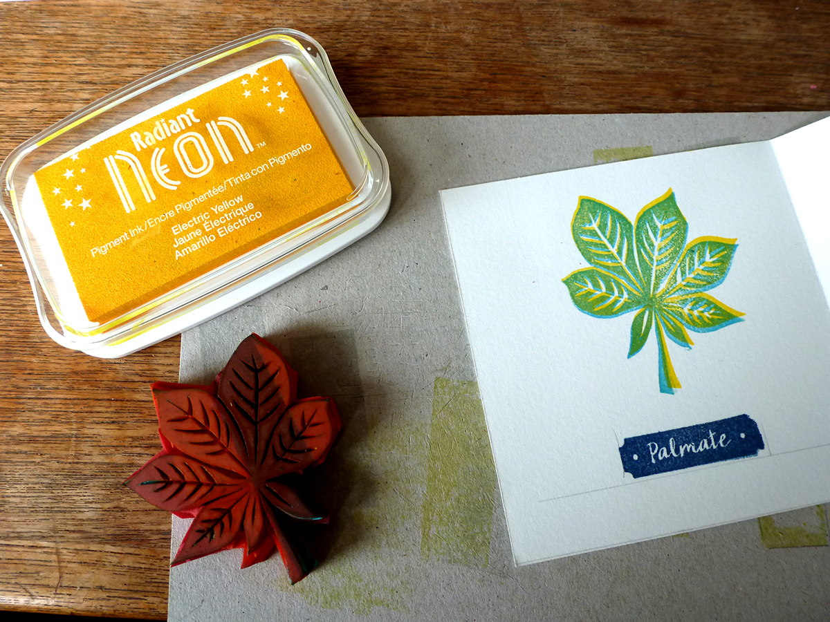 Leaves printed in yellow and blue neon ink, labels printed in midnight blue