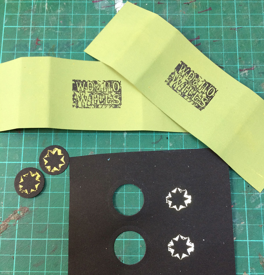 Belly bands printed with a photo-polymer stamp of the company name and a metallic heat transfer foil for the seal on the back.