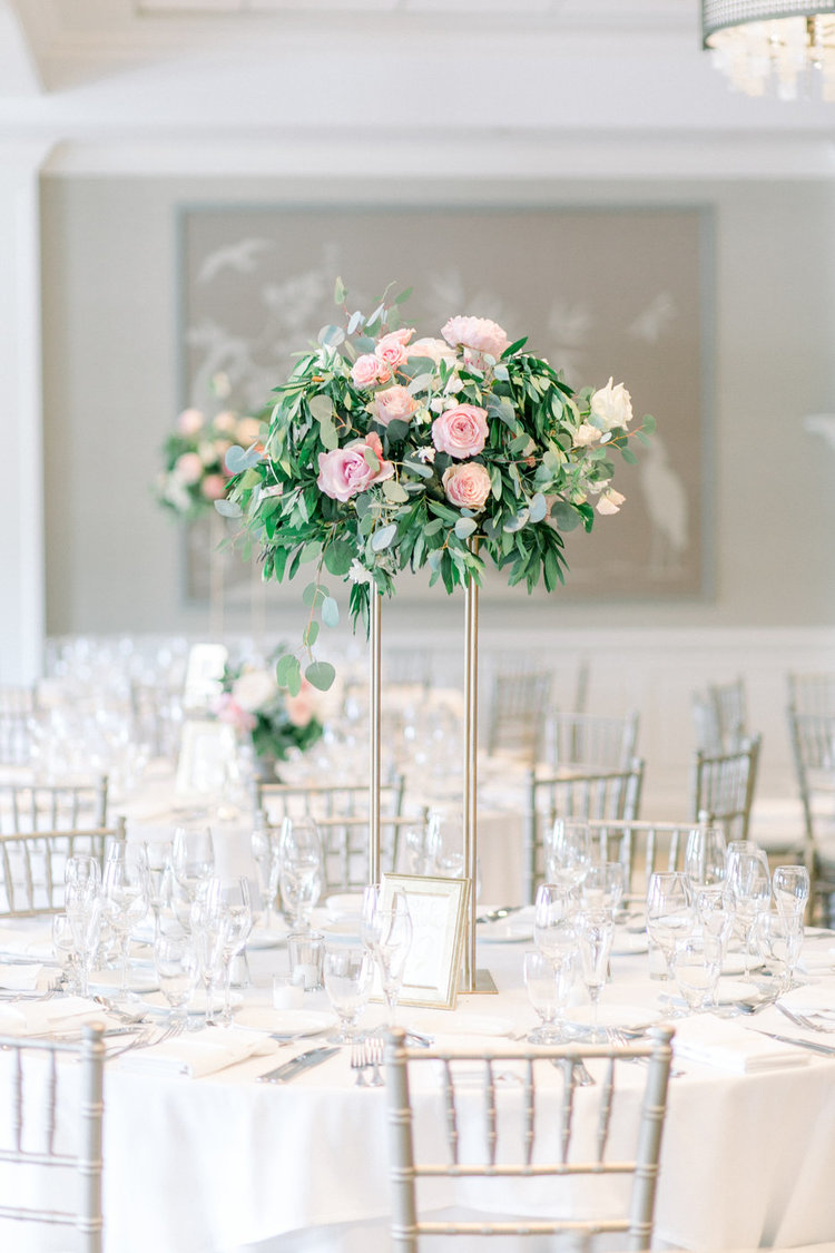 Shorehaven Golf Club wedding tall centerpieces pink greens roses.jpg