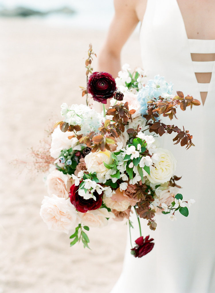 beach wedding bridal bouquet maroon blush ranunculus roses.jpg