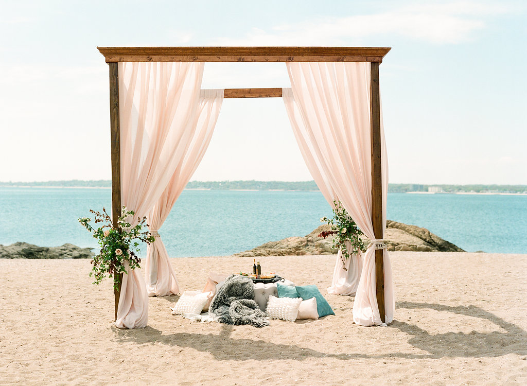 beach wedding chuppah arbor draping floral ceremony greens.jpg