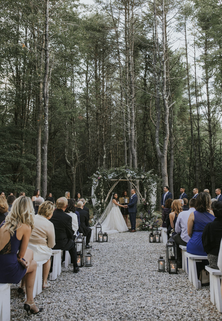 Flanagan farm maine wedding ceremony arbor chuppah floral greens whites aisle lanterns.jpg