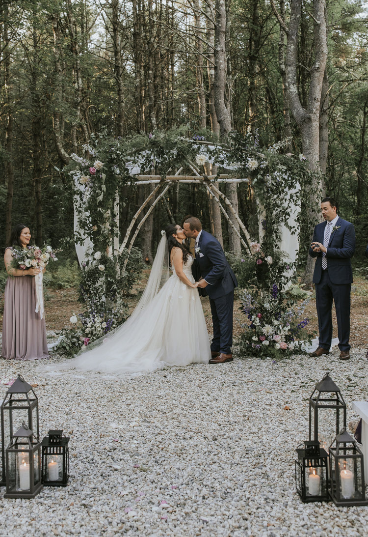 Flanagan farm maine wedding ceremony chuppah arbor floral greens draping aisle lanterns bridal bouquet.jpg