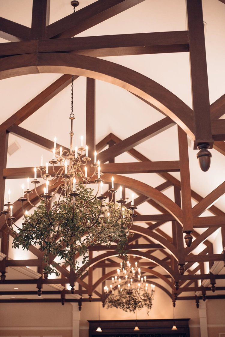 Woodstock Connecticut wedding chandeliers hanging greens smilax.jpg