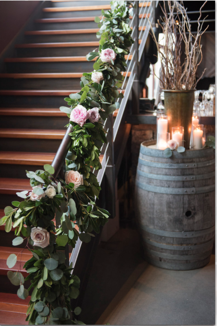 Saltwater Farm Vineyard wedding reception candles stairway garland greens floral pink garden roses.png
