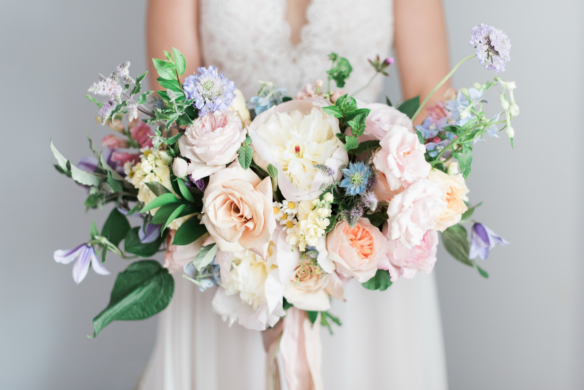 Bridal bouquet garden rose peonies clematis purple scabiosa.jpg