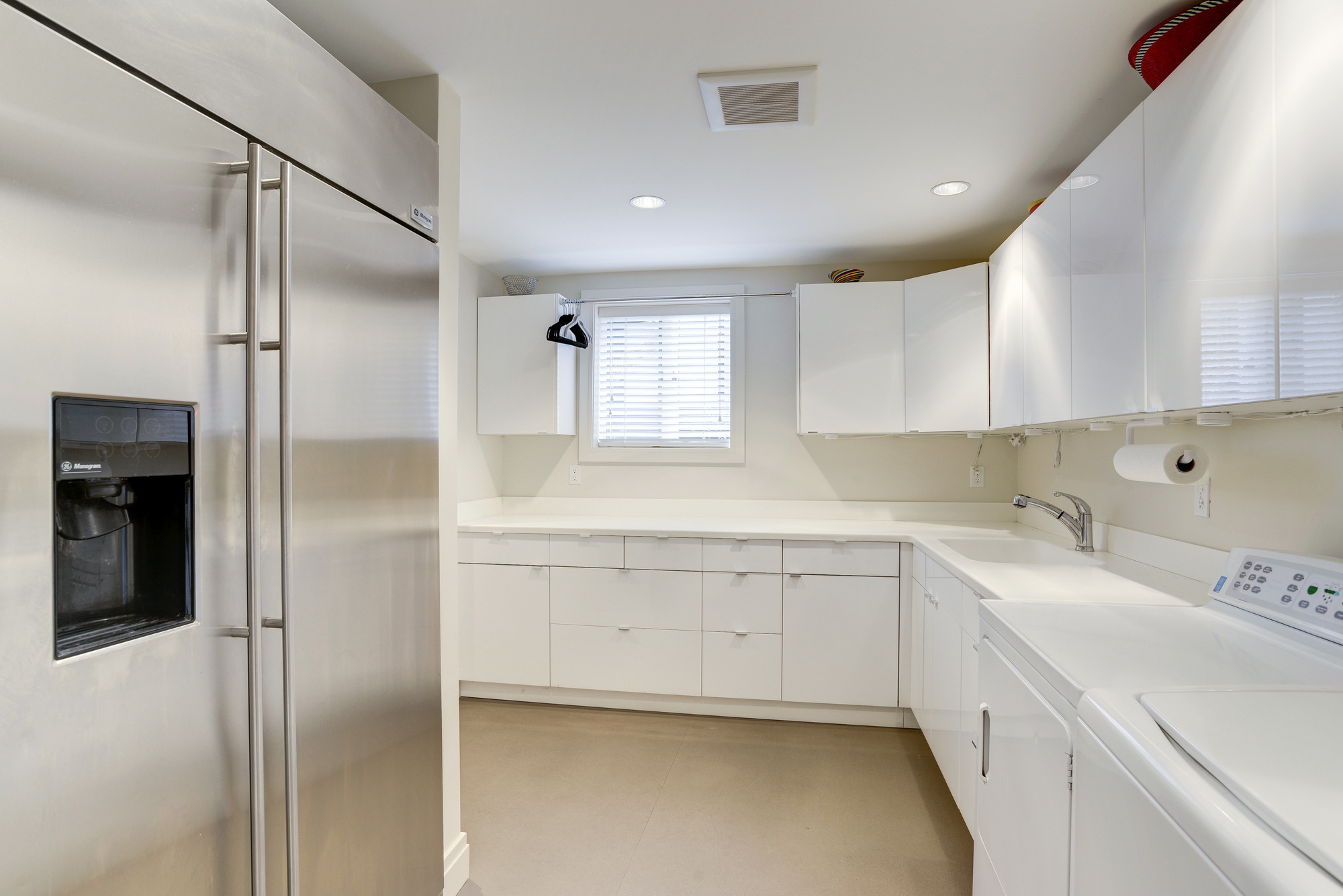 Laundry Room with Additional Storage & Refrigerator