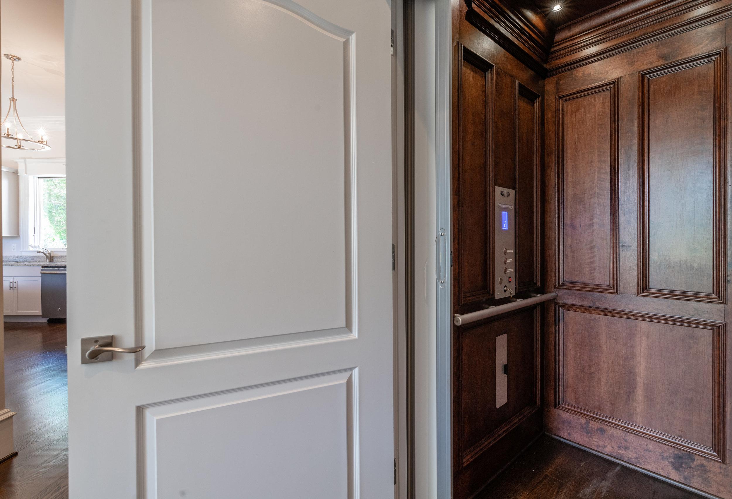 Paneled elevator serves all levels