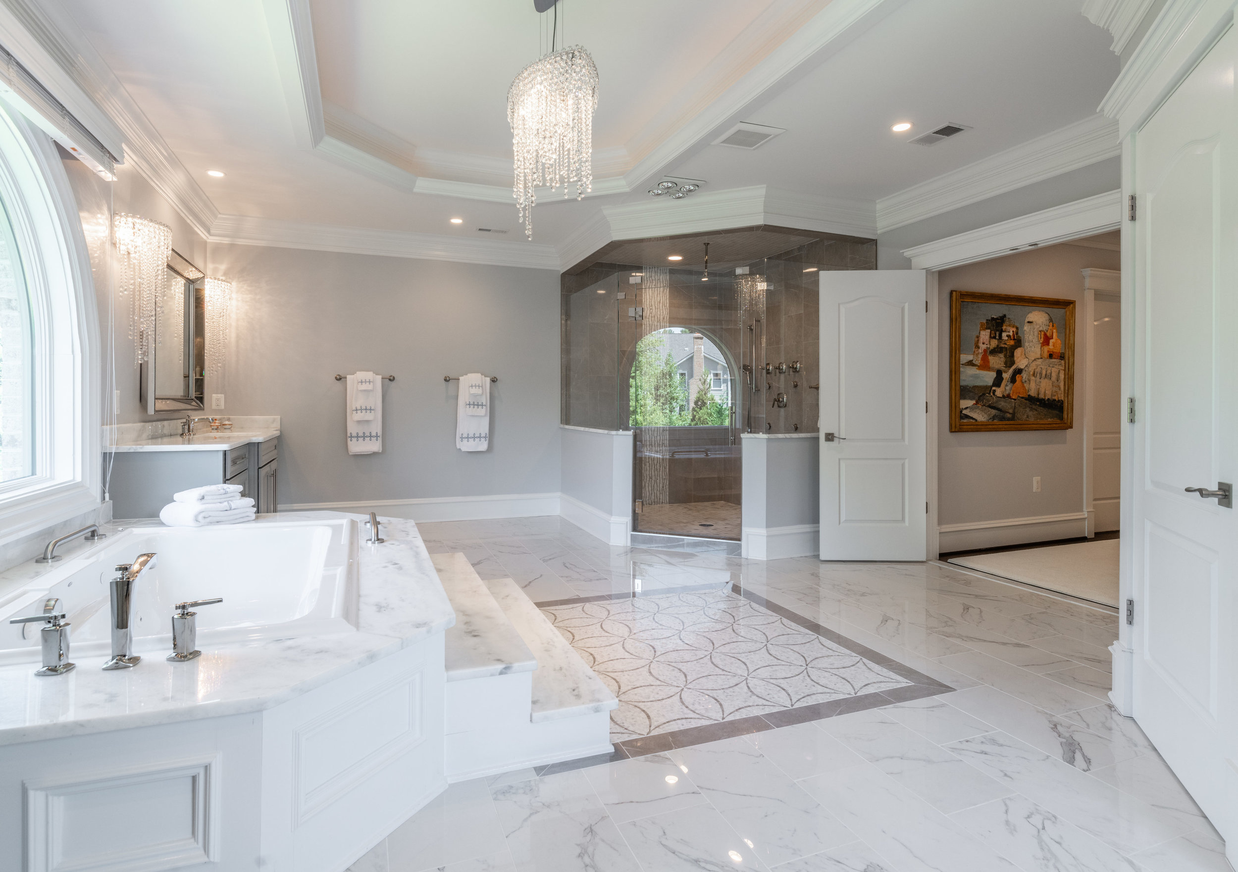Master Bathroom with jetted tub and spacious frameless glass shower