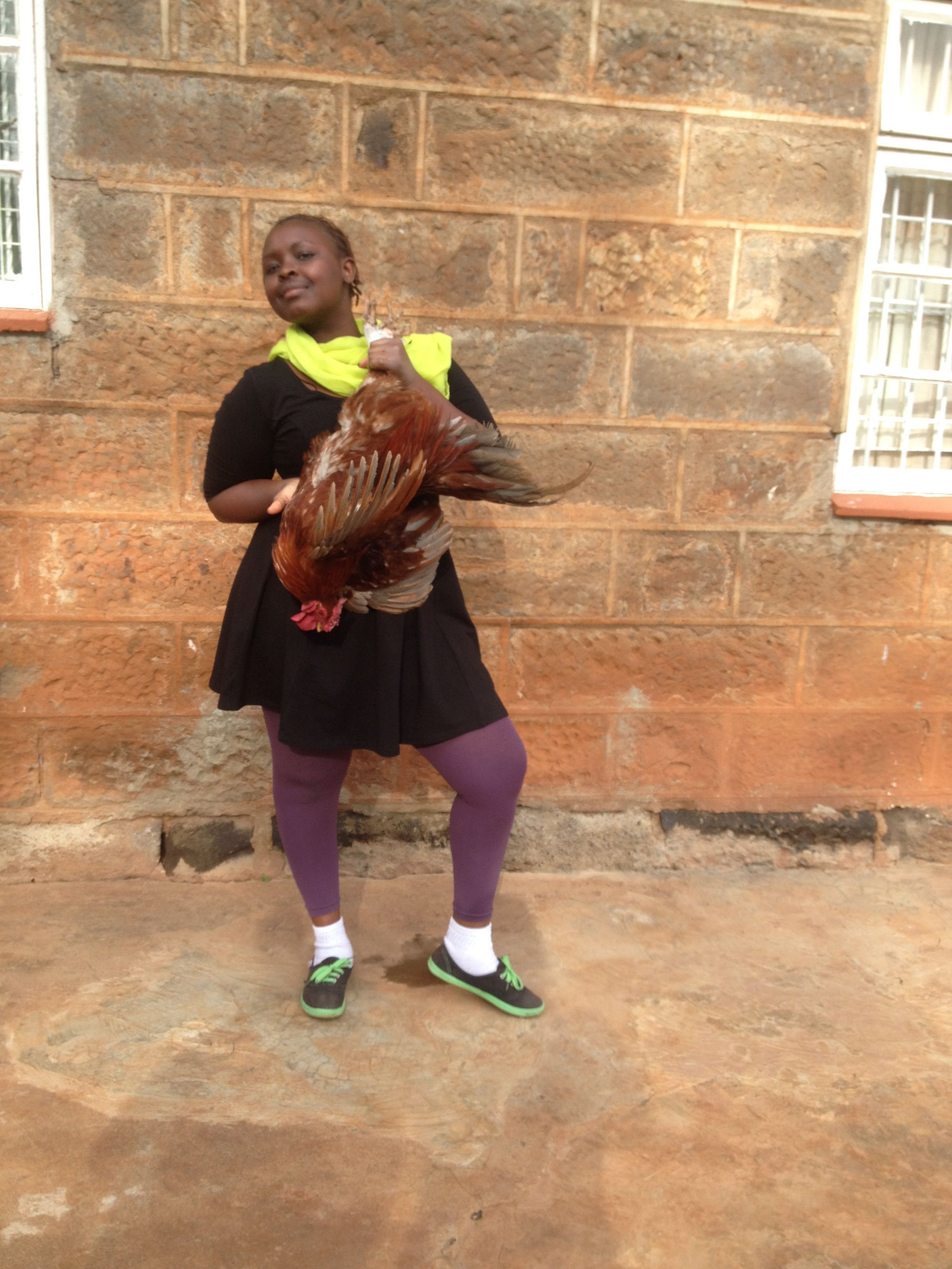 Martha poses with a chicken she bought at the market for our Dirty Bird episode.