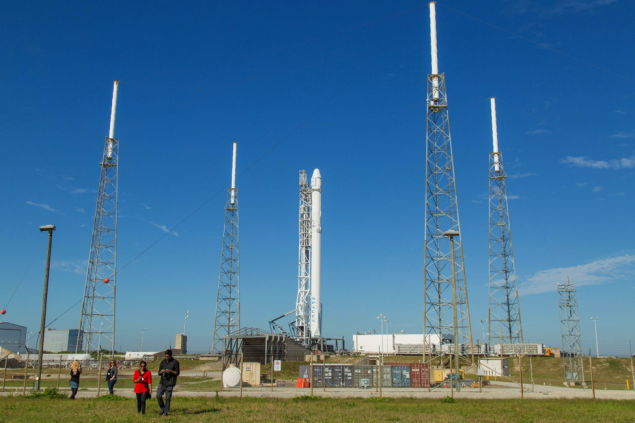 Reporters gather at SpaceX Launch Complex 40 to visit the Falcon 9 rocket. Photo credit: Michael Seeley)