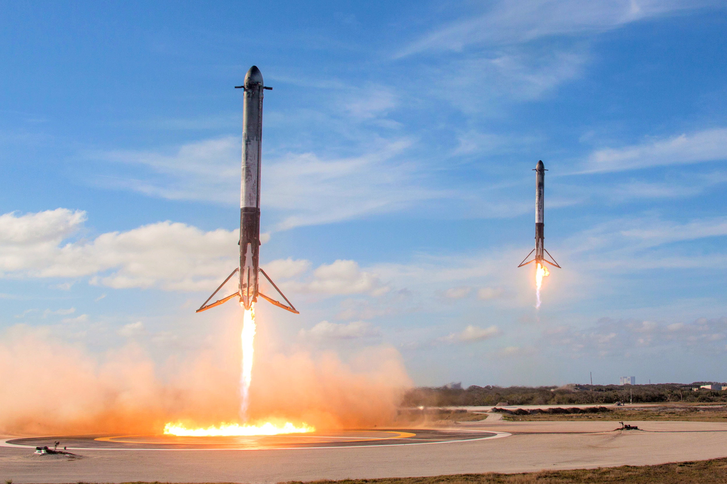 Falcon Heavy side boosters above Landing Zones 1 and 2, February 2018. Photo credit: SpaceX