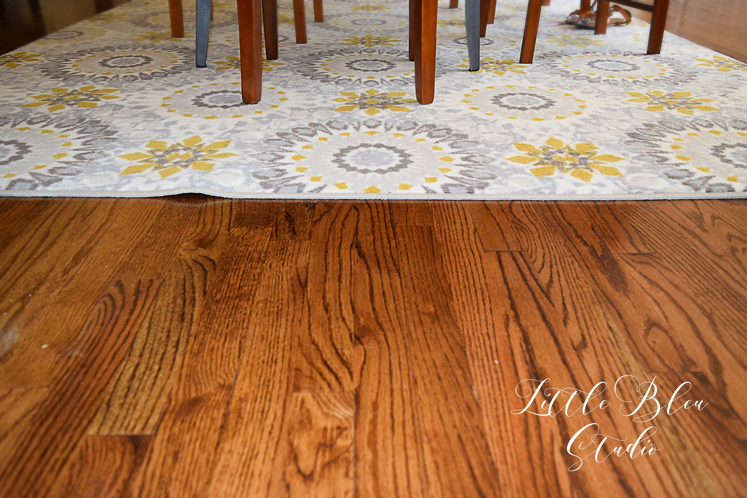 Close up of the dining room floors & my amazing new rug! I love a good Target Sale!
