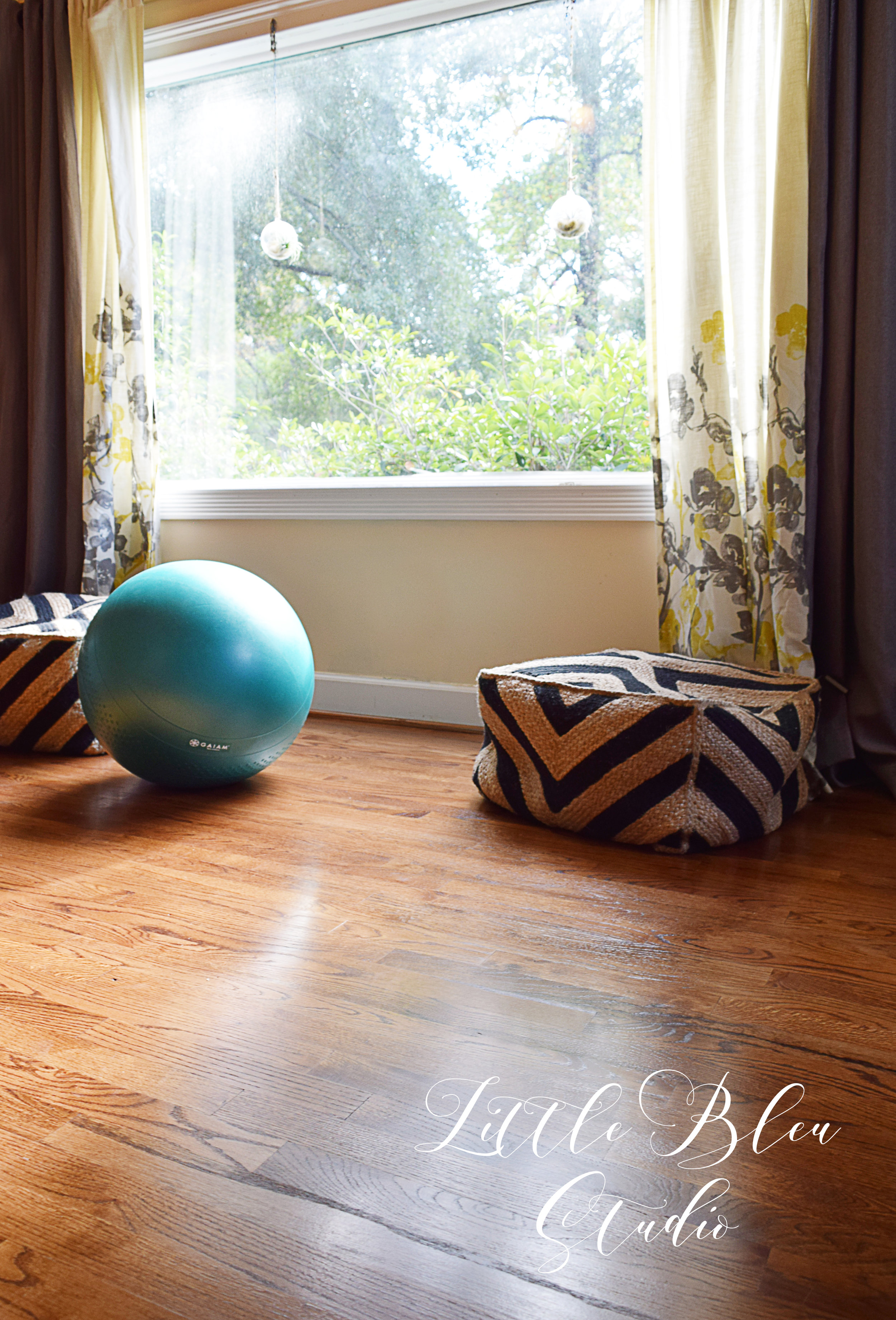 Since this space is so huge, I have another little sitting area here. This is the space that I'll have my yoga mat too!