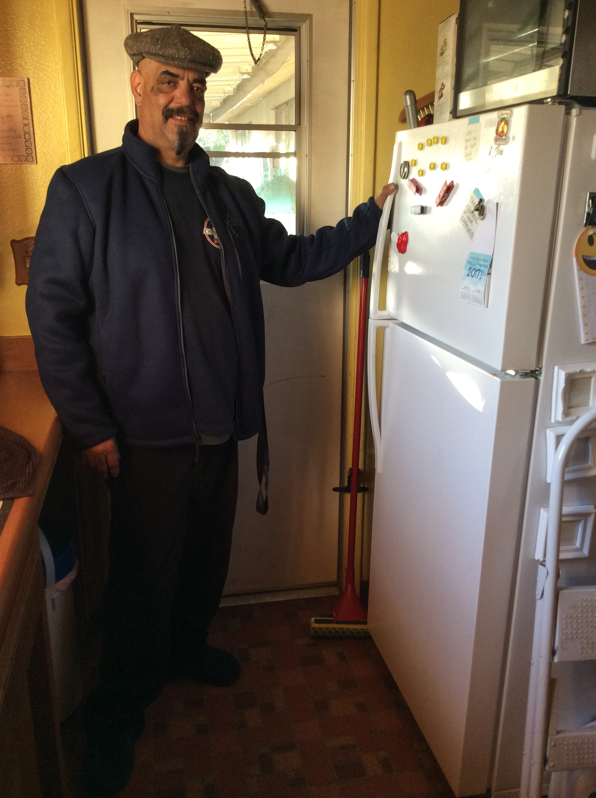 Jose with his new refrigerator