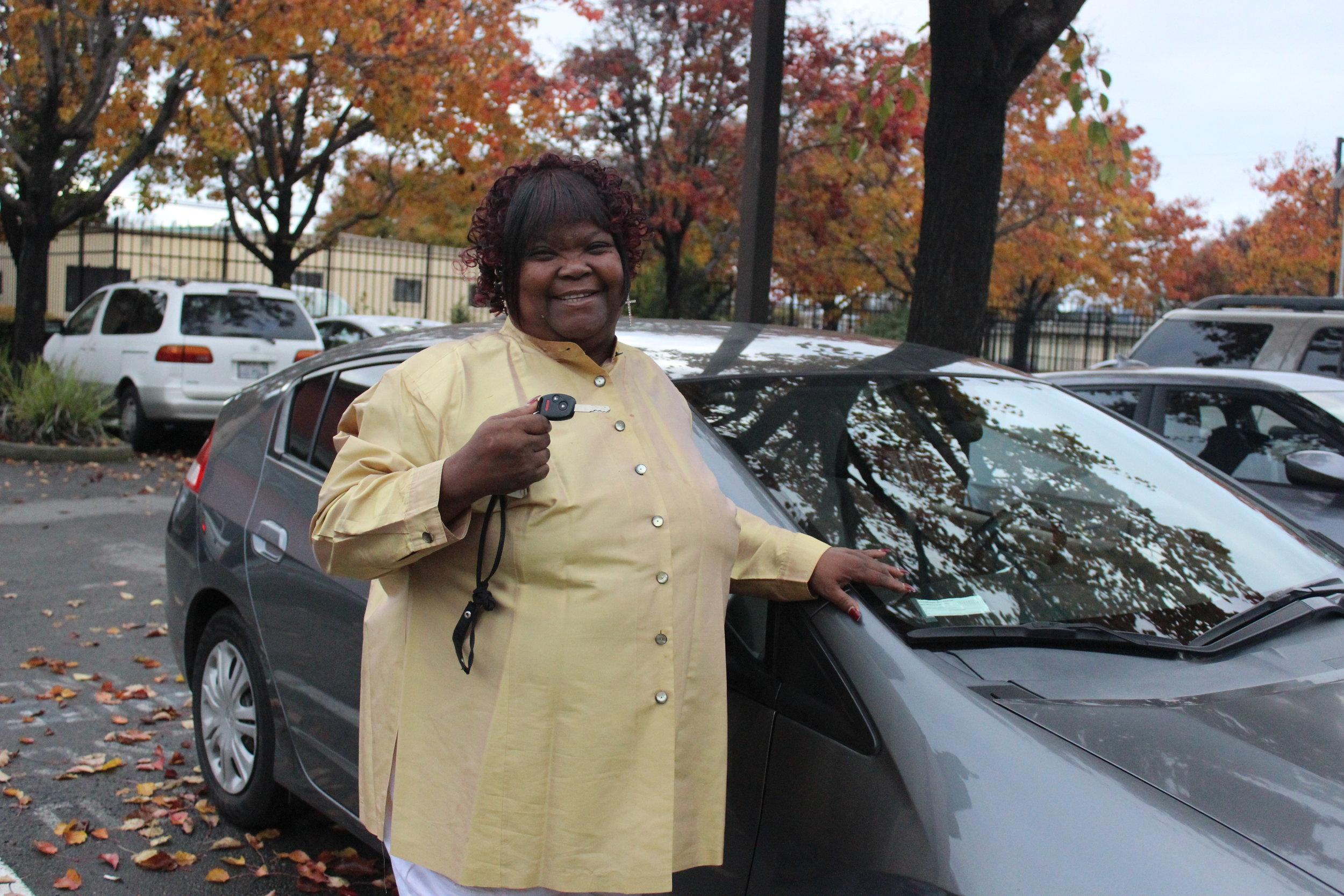 Marie Deer receives the keys to her new clean car