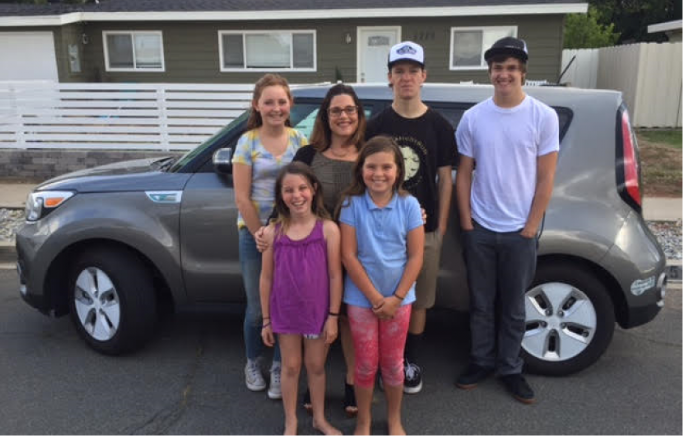 Family with their new clean vehicle