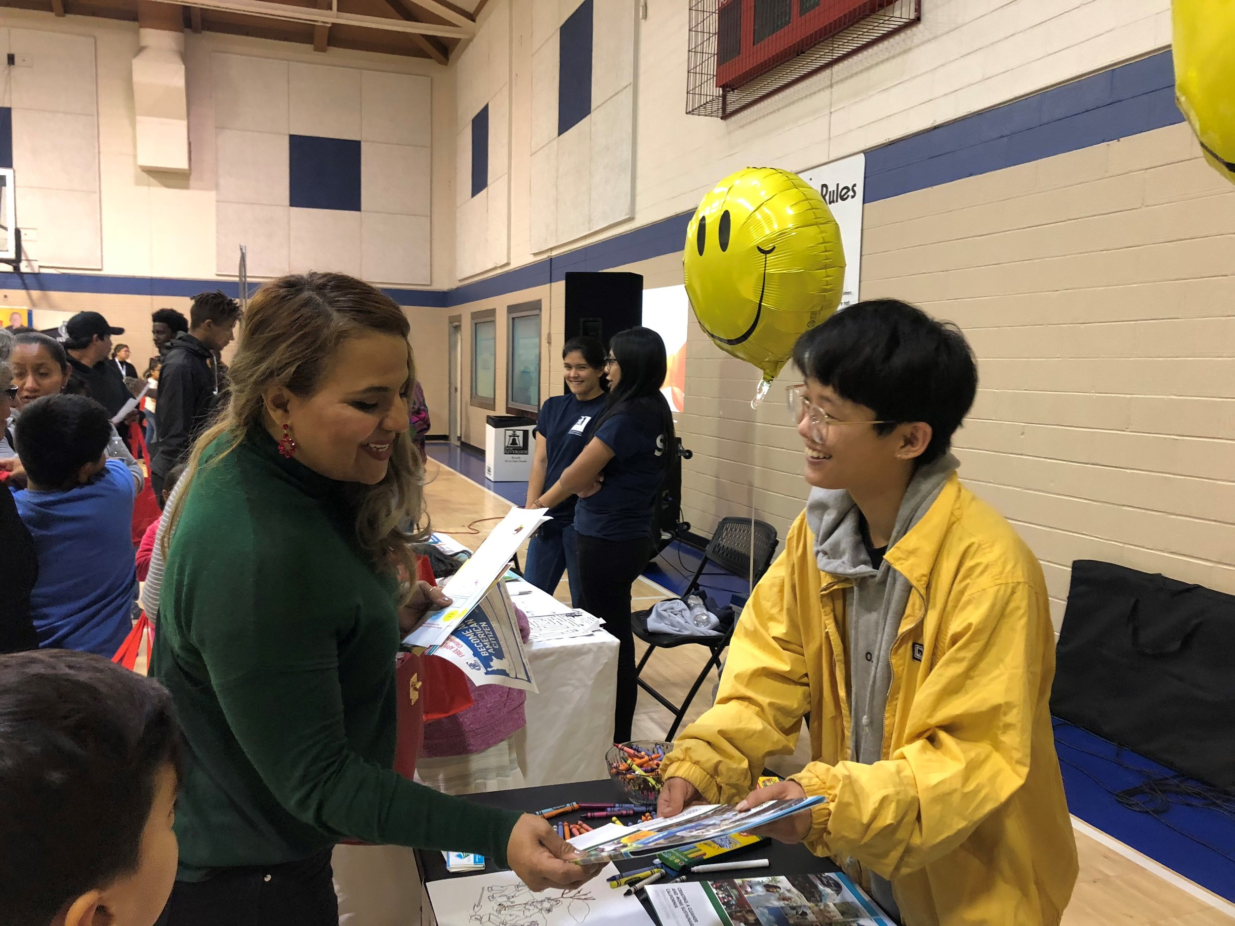 Student ambassador isabel shares information at an outreach table