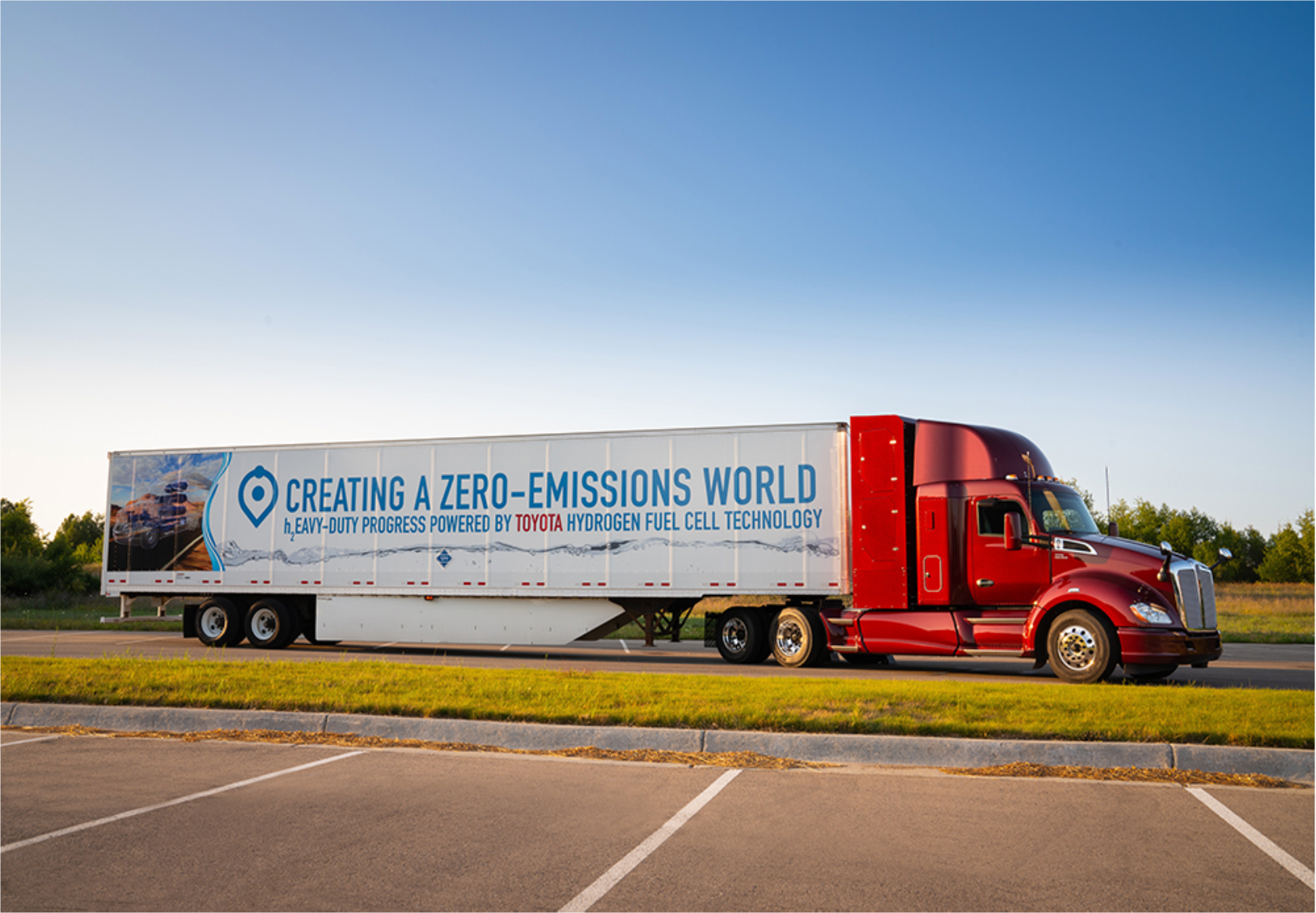 on-road advanced technology freight demonstration projects, california climate investments. image depicts a large red truck with the words, creating a zero-emissions word, heavy-duty progress powered by toyota hydrogen fuel cell technology, written on the side.