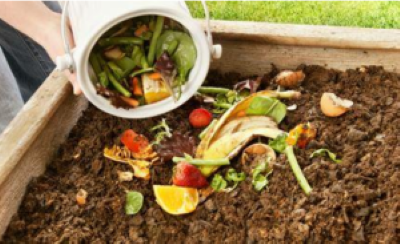 Organics and recycling manufacturing loans, california climate investments. image depicts a compost pile with food scraps and dirt.