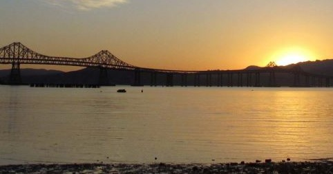 Coastal resilience planning, california climate investments. image depicts the san francisco bay with the bay bridge.