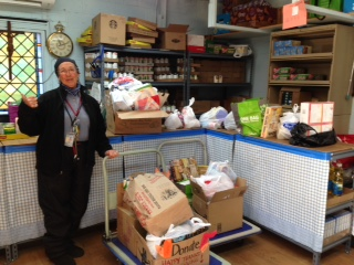 Lourdes from the st. mary's food pantry was excited to receive our donations!