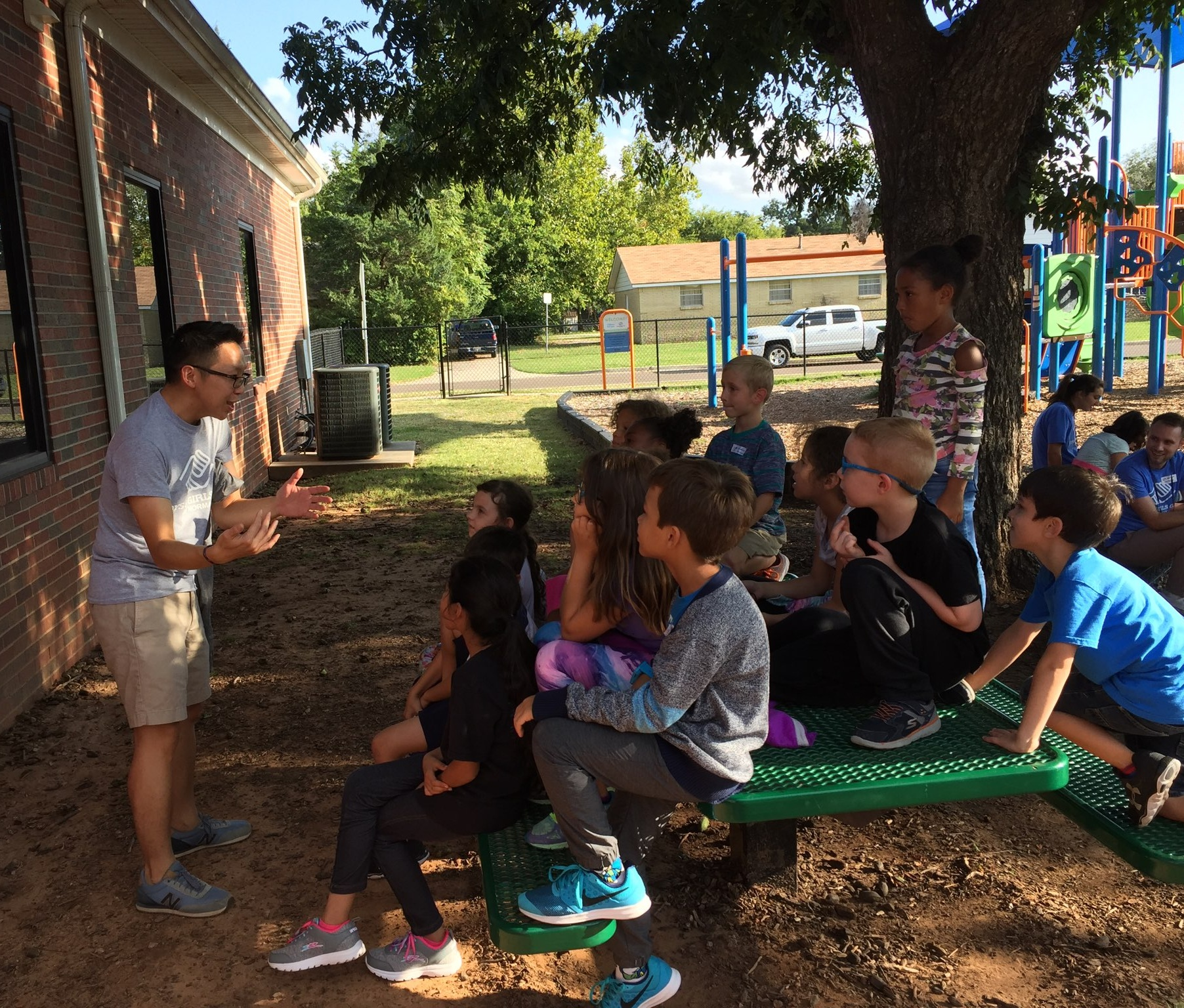 Volunteer engaging with kids, telling a story at BGCN.jpg