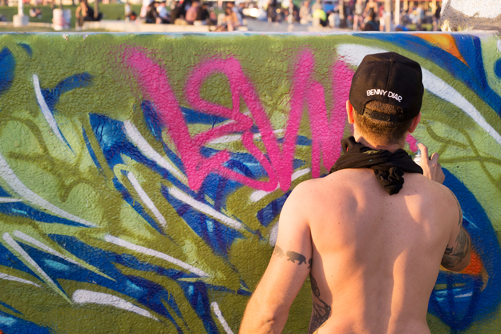 Travis, you are shirtless & also awesome XD! Here he is tagging their name on the wall!