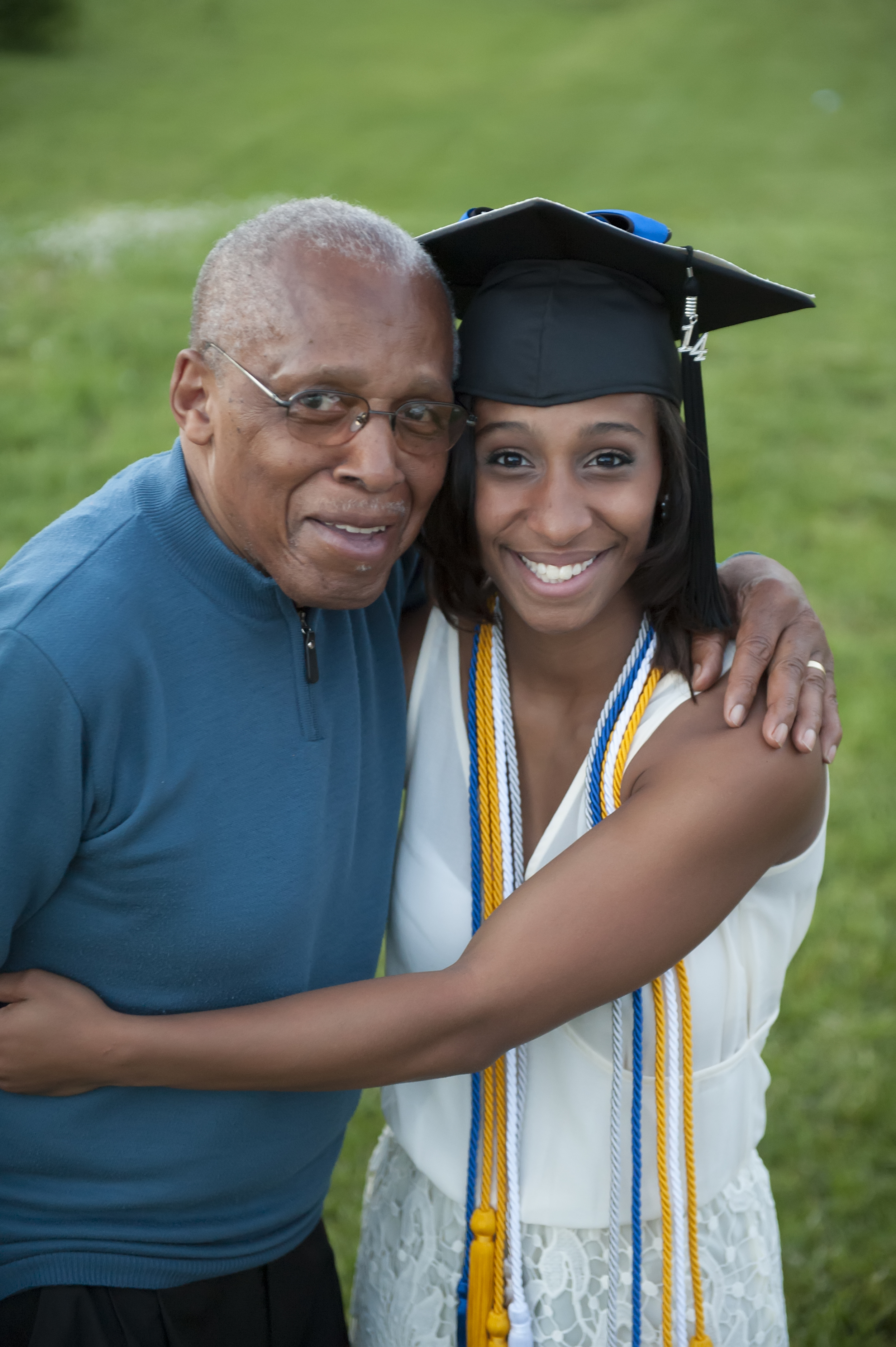 Grandfather with his daughter at her graduation