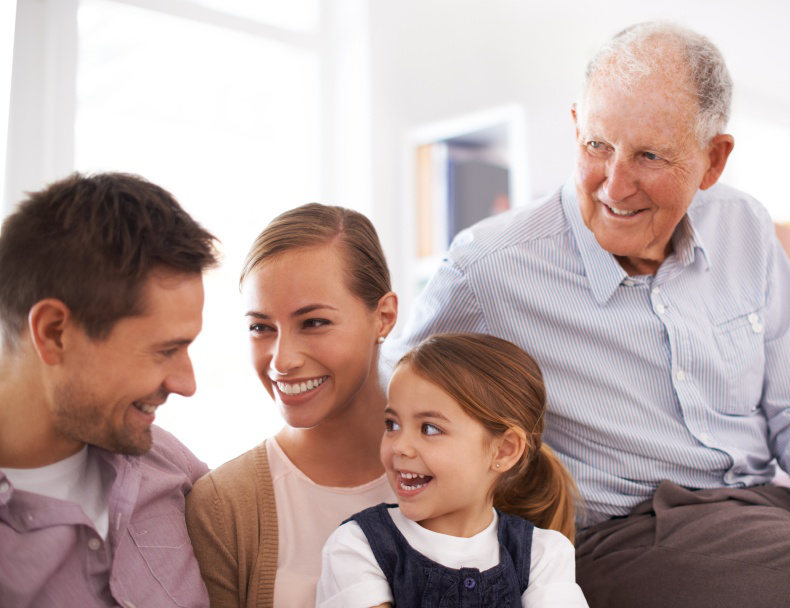 Grandfather enjoying time with his children and grandchildren