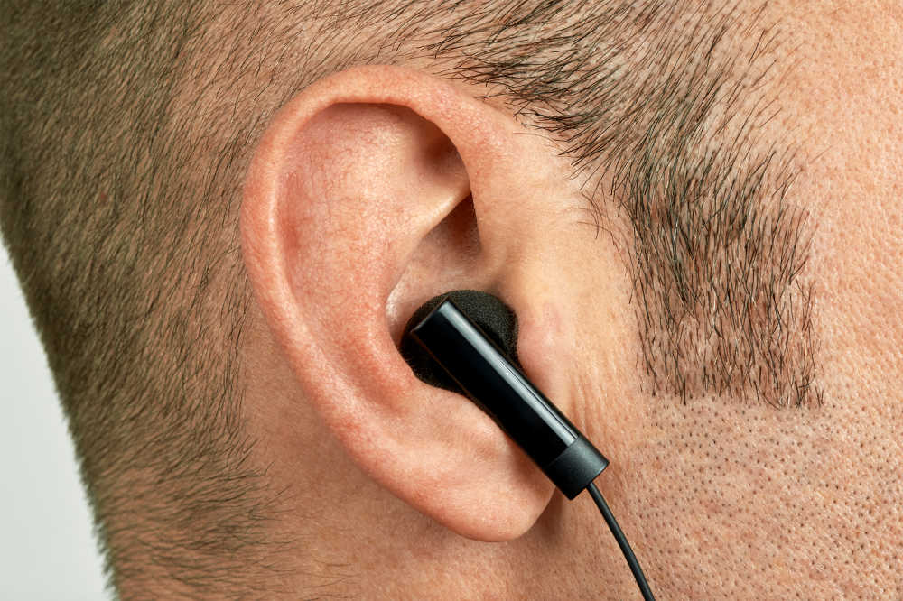 Headphones/Earbuds fitting into an ear